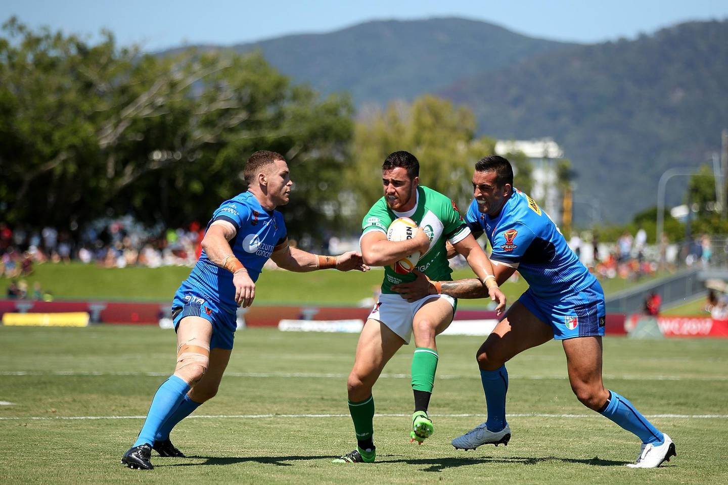 CAIRNS, AUSTRALIA - OCTOBER 29:  Api Pewhairangi of Ireland is tackled during the 2017 Rugby League World Cup match between Ireland and Italy at Barlow Park on October 29, 2017 in Cairns, Australia.  (Photo by Chris Hyde/Getty Images)