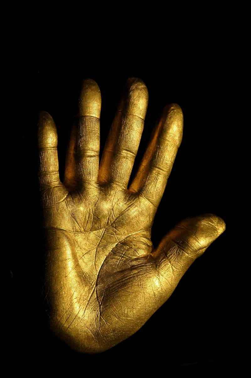 """At the auction of Nelson Mandela's artwork from Robben Island, his former prison, a solid fine gold casting of Mandela's right hand was auctioned. A Johannesburg carpet dealer, Shraga Vidavsky, bought the hand for Rands 425,000 (approximately US$53,000.) The hand, 3 kilograms of pure gold, bears his signature and one of the years of his imprisonment on the back. The hand was cast by South African Harmony Gold Company. Twenty-seven hands will be made for auction, one for each year of imprisonment. The proceeds from the auction of the gold hands and of Mandela's artwork will benefit the """"Nelson Mandela Trust"""" and the charities it supports. On July 3, another fundraising event with Nelson Mandela will be held in London. The star-studded guest list includes David Beckham and his wife. --- Photo by Louise Gubb/Corbis SABA (Photo by Louise Gubb/Corbis via Getty Images)"""