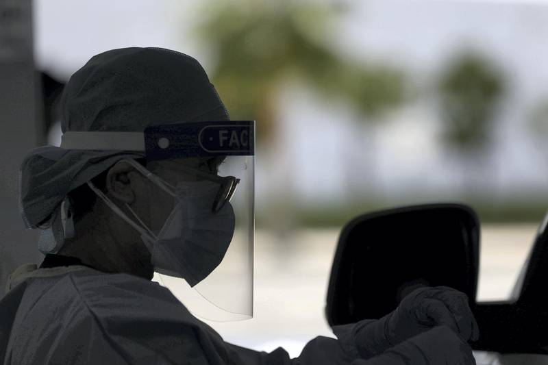 Dubai, United Arab Emirates - Reporter: Patrick Ryan. News. Covid-19/Coronavirus. A health worker wears PPE as people go to be tested at the City Walk screening centre in Dubai. Thursday, July 2nd, 2020. Dubai. Chris Whiteoak / The National