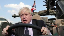 UK's May calls for Boris Johnson to apologise over burqa comments