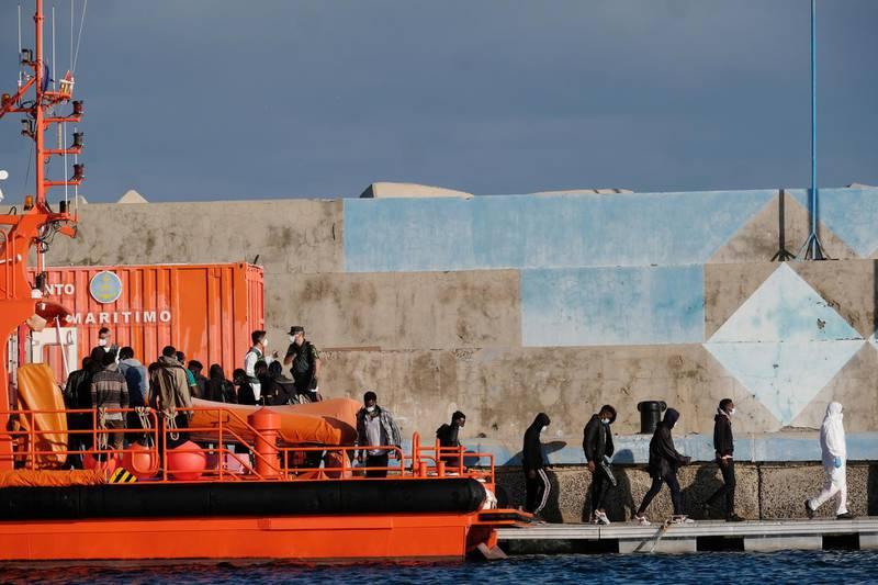 epa09278592 Several migrants disembark in the port in Gran Tarajal, Fuerteventura island, southwestern Spain, 16 June 2021 (issued on 17 June 2021). Spanish authorities rescued 54 migrants off the coasts of Fuerteventura.  EPA/Carlos de Saa