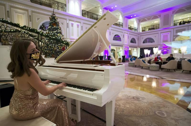 Ras Al Khaimah, United Arab Emirates: A pianist entertaining few guests at Waldorf Astoria, Al Hamra Island, RAK.  Leslie Pableo for The National