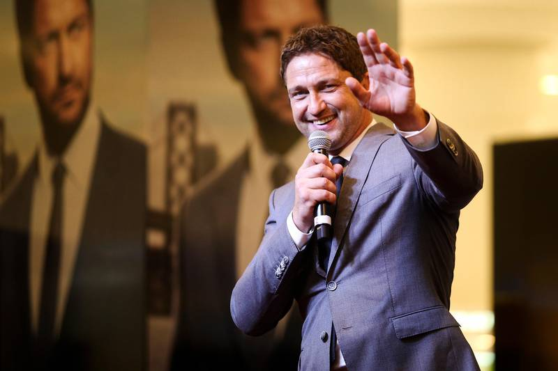 Dubai, UAE, March 20, 2015:Gerard Butler greeted fans today at the Paris Gallery in Dubai Mall. The actor is a brand ambassador for Hugo Boss and as such does various promotional campaigns for the brand.He is seen here waving to a fan who pulled out a Scottish flag, Mr. Butler is from Scotland.  Lee Hoagland/The National  *** Local Caption ***  LH0320_GERARD_BUTLER_0001.JPG