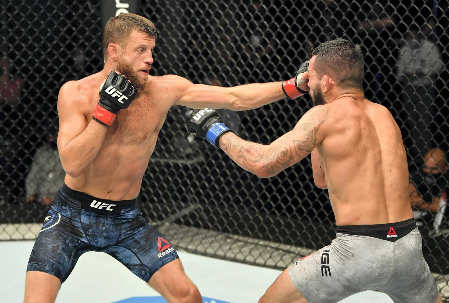 ABU DHABI, UNITED ARAB EMIRATES - JULY 16: (L-R) Calvin Kattar punches Dan Ige in their featherweight fight during the UFC Fight Night event inside Flash Forum on UFC Fight Island on July 16, 2020 in Yas Island, Abu Dhabi, United Arab Emirates. (Photo by Jeff Bottari/Zuffa LLC via Getty Images)