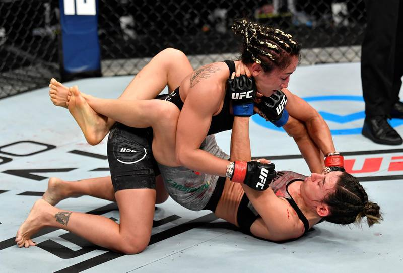 ABU DHABI, UNITED ARAB EMIRATES - JULY 26: (L-R) Carla Esparza punches Marina Rodriguez of Brazil in their strawweight fight during the UFC Fight Night event inside Flash Forum on UFC Fight Island on July 26, 2020 in Yas Island, Abu Dhabi, United Arab Emirates. (Photo by Jeff Bottari/Zuffa LLC via Getty Images)