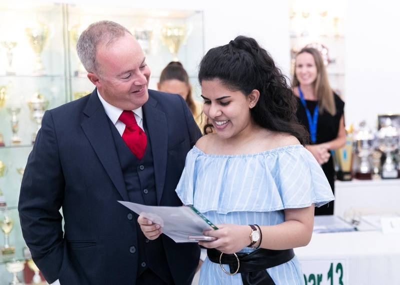 DUBAI, UNITED ARAB EMIRATES. 15 AUGUST 2019. Manal Riza Mohammed,18, receives her A-Level results, with the Prinicipal Simo O'Connor, at Jumeirah College school.(Photo: Reem Mohammed/The National)Reporter:Section: