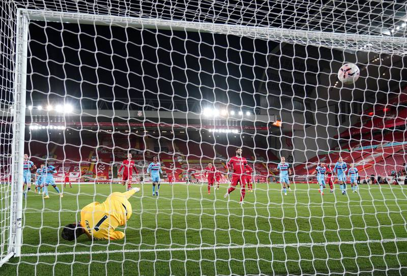 LIVERPOOL, ENGLAND - OCTOBER 31:  Lukasz Fabianski of West Ham United fails to save as Mohamed Salah of Liverpool reacts after scoring a penalty for his team's first goal during the Premier League match between Liverpool and West Ham United at Anfield on October 31, 2020 in Liverpool, England. Sporting stadiums around the UK remain under strict restrictions due to the Coronavirus Pandemic as Government social distancing laws prohibit fans inside venues resulting in games being played behind closed doors. (Photo by Jon Super - Pool/Getty Images)