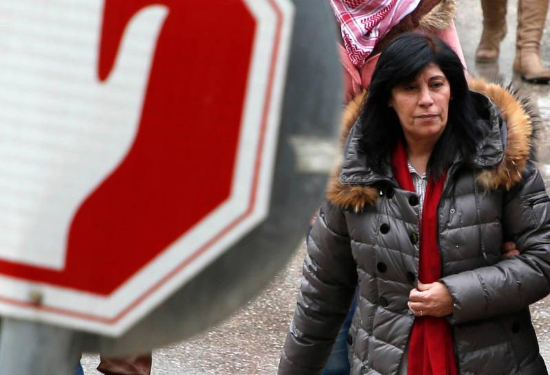 TOPSHOT - Popular Front for the Liberation of Palestine (PFLP) member Khalida Jarrar, 56, walks following her release from an Israeli jail on February 28, 2019, Nablus in the occupied West Bank. Israel released from custody the Palestinian politician who had been held without trial for 20 months over links to an organisation it considers a terrorist group, the Israeli prison service said. She was arrested on July 2, 2017 for being a senior member in the PFLP, a movement considered a terrorist organisation by Israel, the United States and the European Union. / AFP / JAAFAR ASHTIYEH