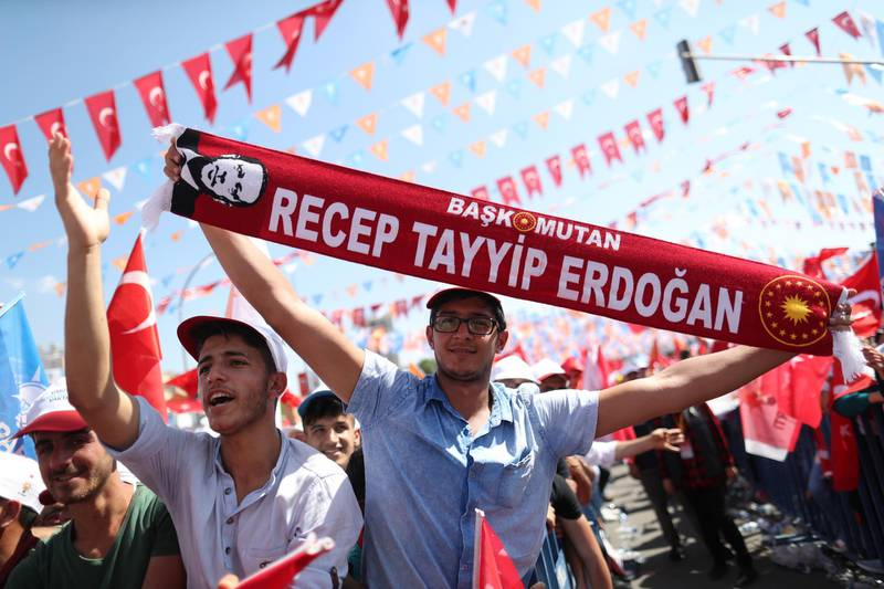 epa06824402 Supporters of Turkish President Recep Tayyip Erdogan hold scarfs reading on 'Chief commander Recep Tayyip Erdogan' during an election campaign rally of Justice and Development Party (AK Party) in Sanliurfa, Turkey, 20 June 2018. Turkish President Erdogan announced on 18 April 2018 that Turkey will hold snap elections on 24 June.  EPA/ERDEM SAHIN