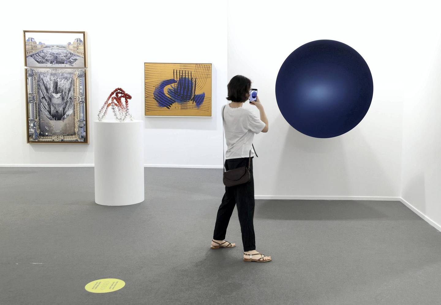 Dubai, United Arab Emirates - Reporter: Alexandra Chaves. Arts and Lifestyle. A visitor looks at a piece by Anish Kapoor called Monochrome. Art Dubai 2021 opens at the DIFC. Tuesday, March 30th, 2021. Dubai. Chris Whiteoak / The National