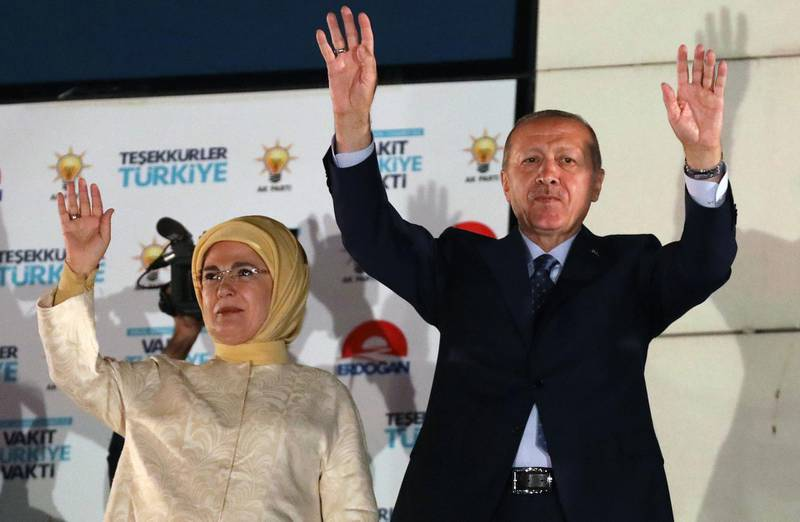 Turkish President Tayyip Erdogan and his wife Emine Erdogan greet supporters at the AKP headquarters in Ankara, Turkey June 25, 2018. / AFP / Adem ALTAN