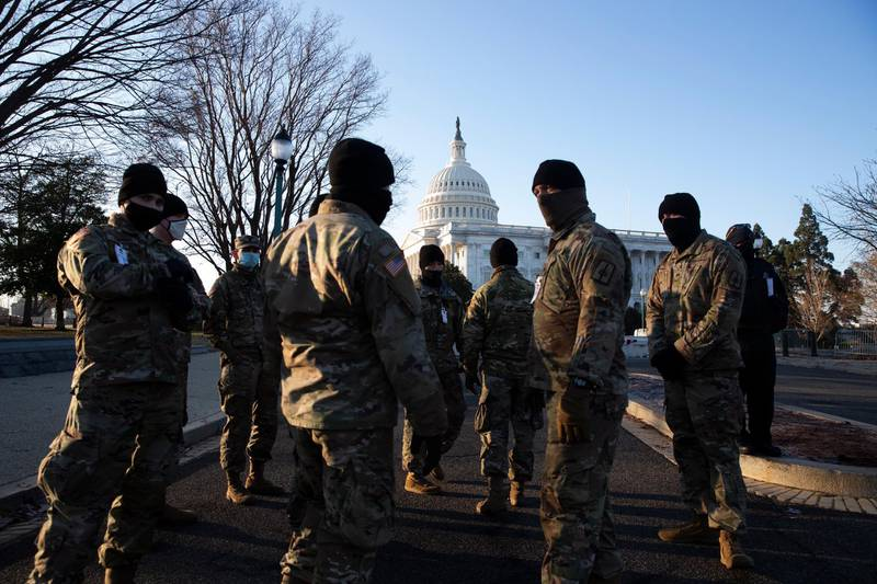 epa08933143 Members of the US National Guard stand on the grounds of the East Front of the US Capitol in Washington, DC, USA, 12 January 2021. At least ten thousand troops of the National Guard will be deployed in Washington by the end of the week, with the possibility of five thousand more, to help secure the Capitol area ahead of more potentially violent unrest in the days leading up to the Inauguration ofUS President-elect Biden. Democrats are attempting to impeach incumbent US President Trump after he incited a mob of his supporters to riot on the US Capitol in an attempt to thwart Congress from certifying Biden's election victory.  EPA/MICHAEL REYNOLDS