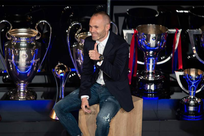 """Barcelona's Spanish midfielder and captain Andres Iniesta gives a thumbs-up during a tribute at the Camp Nou stadium in Barcelona on May 18, 2018.   Iniesta says he will decide """"next week"""" whether to continue his decorated career in either China or Japan. The 34-year-old Barca icon is bringing the curtain down on his two-decade stay with the Spanish champions, with his last game for the club he joined at the age of 12 coming on May 20, 2018.  / AFP / Josep LAGO"""