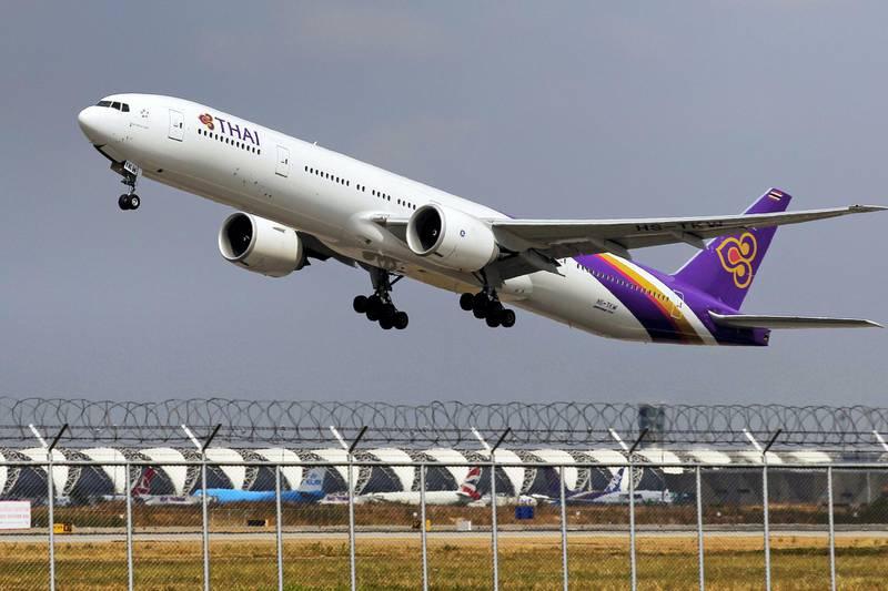 A Thai Airways Boeing 777-300ER plane takes off from Bangkok's Suvarnabhumi Airport February 23, 2015. REUTERS/Chaiwat Subprasom (THAILAND - Tags: TRANSPORT BUSINESS) - GF2EB2N0N8M01