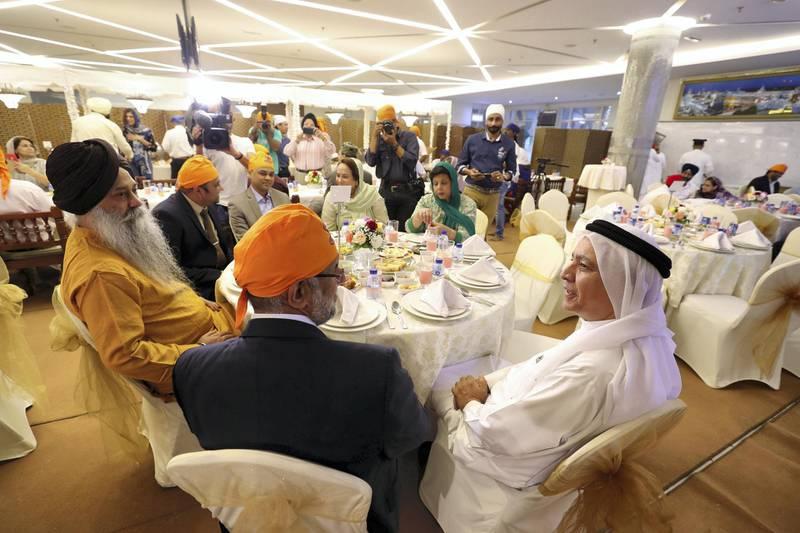 Dubai, United Arab Emirates - May 15, 2019: Navdeep Singh Suri (L), Ambassador of India speaks with HE Mirza Hussain Al Sayegh. People take part in a multi faith Iftar at Gurunanak Darbar Sikh Gurudwara. Wednesday the 15th of May 2019. Jebel Ali, Dubai. Chris Whiteoak / The National