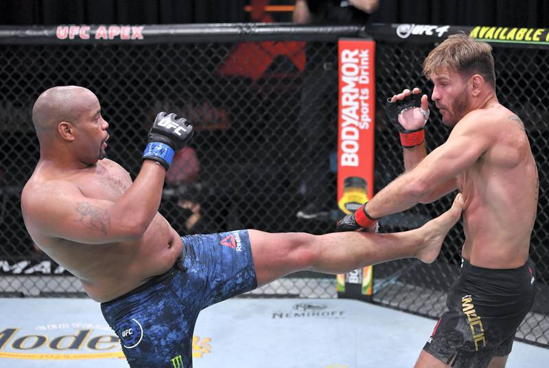 LAS VEGAS, NEVADA - AUGUST 15: (L-R) Daniel Cormier kicks Stipe Miocic in their UFC heavyweight championship bout during the UFC 252 event at UFC APEX on August 15, 2020 in Las Vegas, Nevada. (Photo by Jeff Bottari/Zuffa LLC)