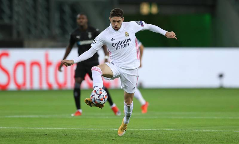 MOENCHENGLADBACH, GERMANY - OCTOBER 27: Federico Valverde of Madrid runs with the ball during the UEFA Champions League Group B stage match between Borussia Moenchengladbach and Real Madrid at Borussia-Park on October 27, 2020 in Moenchengladbach, Germany. (Photo by Lars Baron/Getty Images)