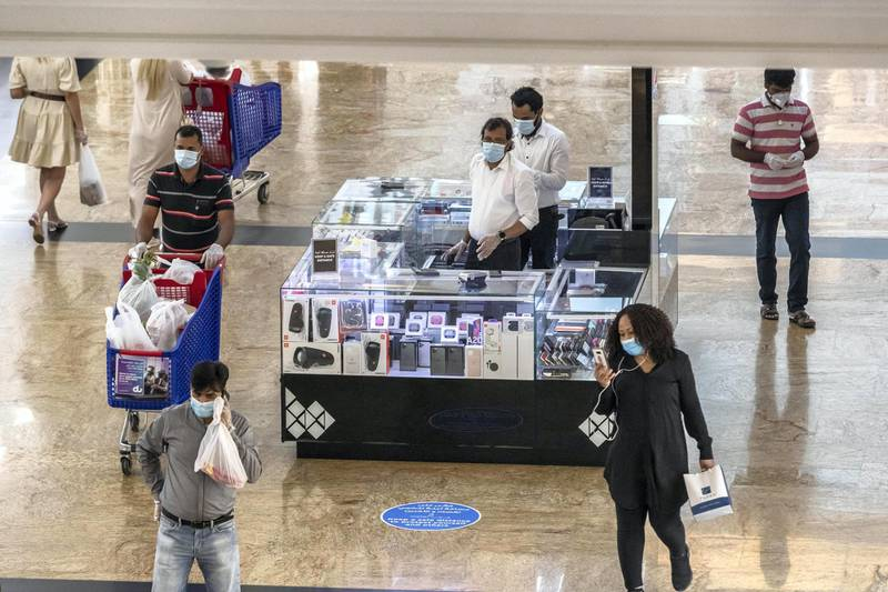 DUBAI, UNITED ARAB EMIRATES. 24 MAY 2020. The first day of the Eid holidays saw shoppers head to Mall of the Emirates to shop for both food and luxury items. Mall staff have put in place thermal scanning at entry ways and shops are supplying hand santizer and in some cases glothes when shoppers enter the stores. Social distancing is also being observed for the most part as restrictions are in place by Dubai Government. (Photo: Antonie Robertson/The National) Journalist: Kelly Clarke. Section: National.