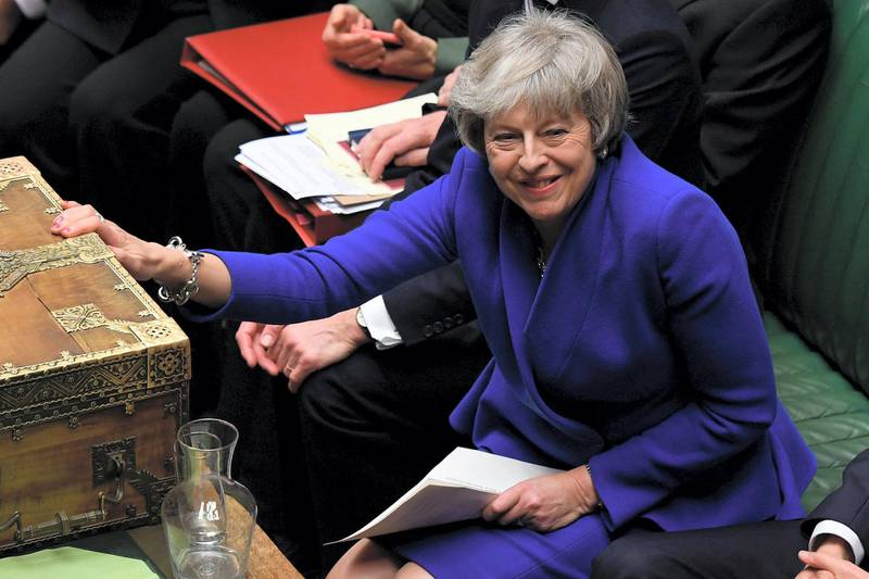 """A handout photograph released by the UK Parliament's shows Britain's Prime Minister Theresa May (C) as she reacts during a debate on a no confidence motion in the House of Commons in central London on January 16, 2019. - British Prime Minister Theresa May on Wednesday narrowly survived a no-confidence vote sparked by the crushing defeat of her Brexit deal just weeks before the UK leaves the European Union. (Photo by JESSICA TAYLOR / UK PARLIAMENT / AFP) / RESTRICTED TO EDITORIAL USE - NO USE FOR ENTERTAINMENT, SATIRICAL, ADVERTISING PURPOSES - MANDATORY CREDIT """" AFP PHOTO / Jessica Taylor / UK Parliament"""""""