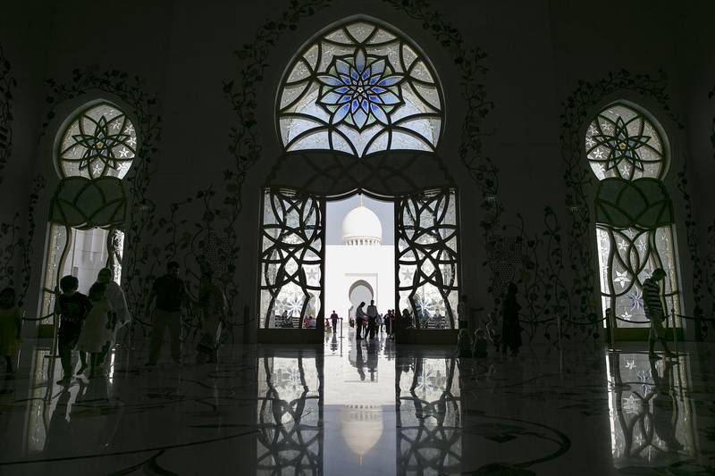Abu Dhabi, United Arab Emirates, Oct. 13, 2013 ///  Sheikh Zayed Grand Mosque still gets plenty of admirers in tourists while many local and expatriate residents either still work or have already head out of the town for the Eid al Adha holiday on Sunday, Oct. 13, 2013, at the mosque in Abu Dhabi. (Silvia Razgova / The National)  Section:   Publication:  Reporter: Standalone    *** Local Caption ***  SR-131013-grandmosque041.jpg