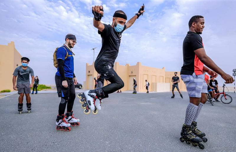 Abu Dhabi, United Arab Emirates, August 21, 2020.   The Madrollers skating group at the Al Wathba Bicycle Track do a  8 km. fun sprint.  The skating group has members from Dubai and Abu Dhabi.  They encourage safety and discipline on roller-skates, skateboard, long-board and bicycles.  --Rollerbladers do limbering exercises and some jumps before going on the 8 km fun sprint.Victor Besa /The NationalSection:  Photo ProjectReporter: