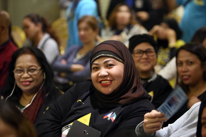 Members of the Filipino community working and residing in Kuwait attend a meeting with their country's Labour Department Undersecretary for Workers Protection, Human Resource, and Internal Auditing Services Cluster, at the Philippines' Embassy in Kuwait City, on February 24, 2018. The employers of the murdered 29-year-old Filipina maid Joanna Demafelis, whose body was found dead in a freezer in Kuwait, were both arrested in the Syrian capital Damascus, a Lebanese judicial official said on February 24. The murder had sparked outrage in the Philippines and prompted President Rodrigo Duterte to impose a departure ban for Filipinos planning to work in Kuwait. / AFP PHOTO / YASSER AL-ZAYYAT