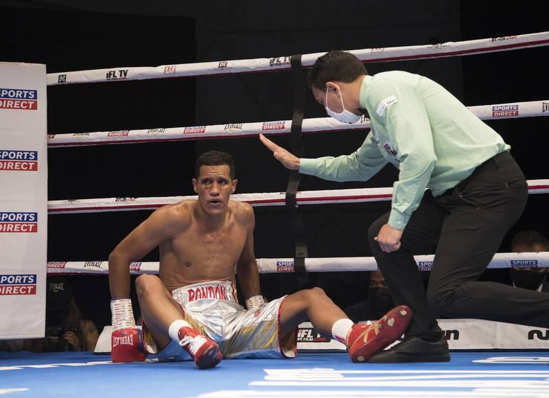 Dubai, United Arab Emirates - Venezuelan boxer Heber Rendon knock off balance by Trusynbay Kulakhmet of Kazakhstan  at the Rotunda, Ceasar's Palace, Bluewaters Island, Dubai.  Leslie Pable for The National