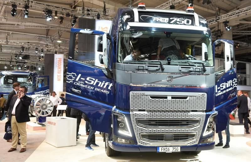 FILE PHOTO: Visitors surround a Volvo FH16 truck at the booth of Swedish truck maker Volvo at the IAA truck show in Hanover, September 22,  2016.  REUTERS/Fabian Bimmer/File Photo
