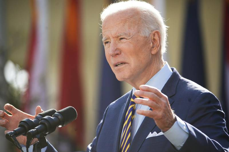 """U.S. President Joe Biden speaks during an event in the Rose Garden of the White House in Washington, D.C., U.S., on Friday, March 12, 2021. Biden offered a Fourth of July goal for the U.S. to begin returning to normal as """"light in the darkness"""" to a weary nation on Thursday, counting on a rapidly expanding supply of coronavirus vaccine to raise American hopes. Photographer: Jim Lo Scalzo/EPA/Bloomberg"""