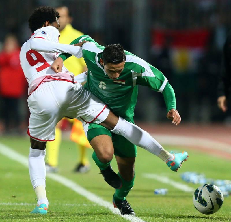 Ali Adnan alk-Tameemi (R) of Iraq vies with Abdelaziz Hussain of UAE during the 21st Gulf Cup's final between United Arab Emirates (UAE) and Iraq on January 18, 2013 in Manama. United Arab Emirates won 2-1 against  Iraq.  AFP PHOTO/MARWAN NAAMANI  *** Local Caption ***  291280-01-08.jpg