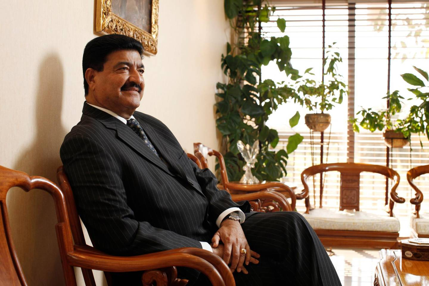 ABU DHABI, UNITED ARAB EMIRATES - December 31, 2009: Dr B. R. Shetty, Managing Director and CEO of NMC Group (NMC Specialty Hospital, UAE Exchange, Neopharma) sits for a portrait in his office.  ( Ryan Carter / The National ) *** Local Caption ***  RC007-DrShetty20091231.jpg