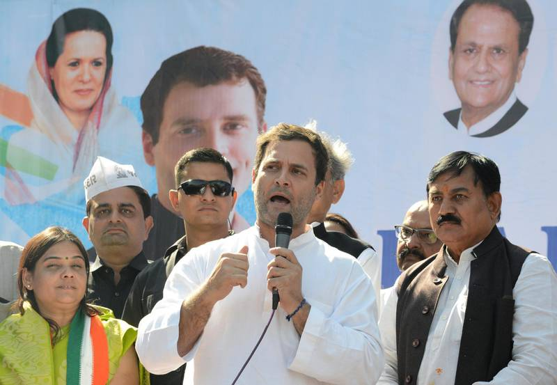 Congress Vice President, Rahul Gandhi (C) addresses a rally in Dahegam, some 40km from Ahmedabad, on November 25, 2017. Voters in Indian Prime Minister Narendra Modi's home state Gujarat will go to the polls against the opposition Congress Party in December in what will be a key test for India's right-wing premier. / AFP PHOTO / SAM PANTHAKY