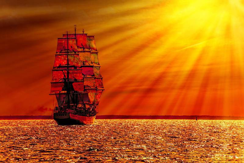 DD0JTF Sailing ship on the sea at sunset skyline.