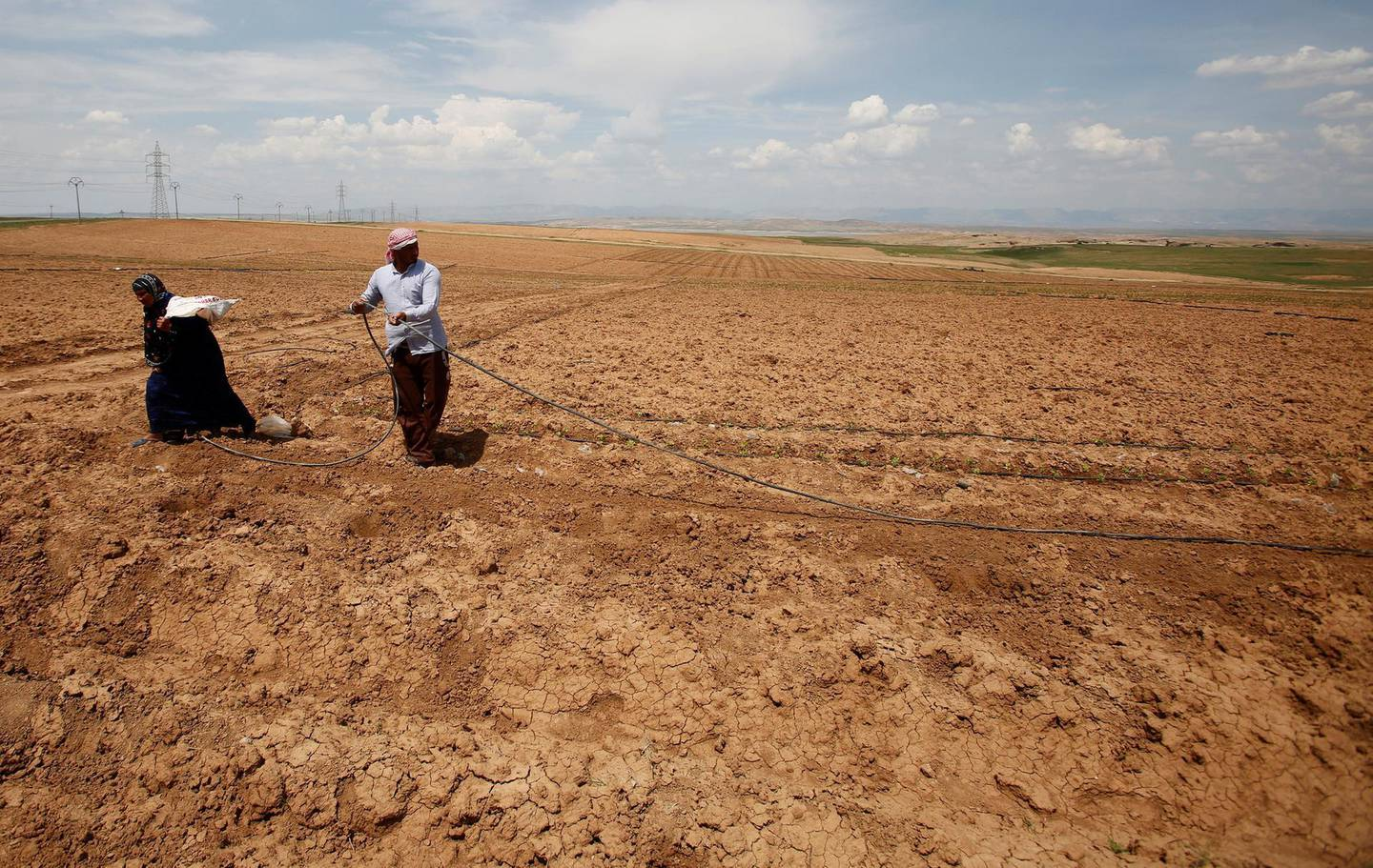 Iraqi farmers work in their fields north of Mosul, Iraq May 2, 2018. Picture taken May 2, 2018.   To match Special Report IRAQ-WATER/NINEVEH      REUTERS/Khalid Al-Mousily