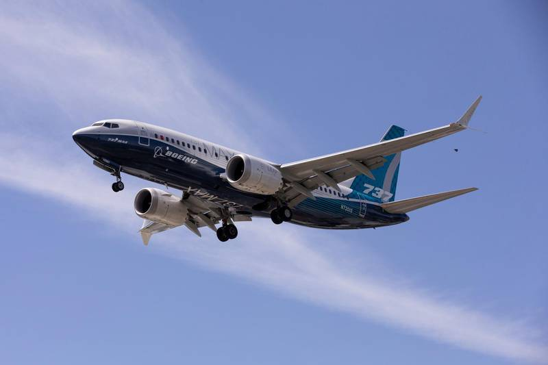 FILE PHOTO: A Boeing 737 MAX airplane lands after a test flight at Boeing Field in Seattle, Washington, U.S. June 29, 2020. REUTERS/Karen Ducey/File Photo  GLOBAL BUSINESS WEEK AHEAD