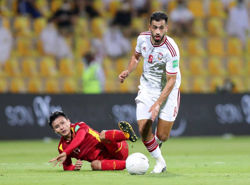 UAE's Majed Hassan battles with Nguyen Quang Hai of Vietnam during the game between the UAE and Vietnam in the World cup qualifiers at the Zabeel Stadium, Dubai on June 15th, 2021. Chris Whiteoak / The National.  Reporter: John McAuley for Sport