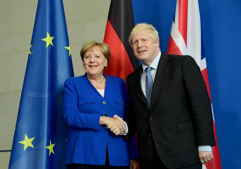 epa07784446 German Chancellor Angela Merkel (L) shakes hands British Prime Minister Boris Johnson after a joint statement at the Chancellery in Berlin, Germany, 21 August 2019. Prior to the G7 summit in Biarritz form 24 to 27 August 2019, Johnson meets Angela Merkel and on the next day French President Emmanuel Macron. In the talks, Johnson is expected to try to resume the Brexit talks, so that it will not come to a 'no deal' exit of the United Kingdom from the EU on 31 October 2019.  EPA/CLEMENS BILAN