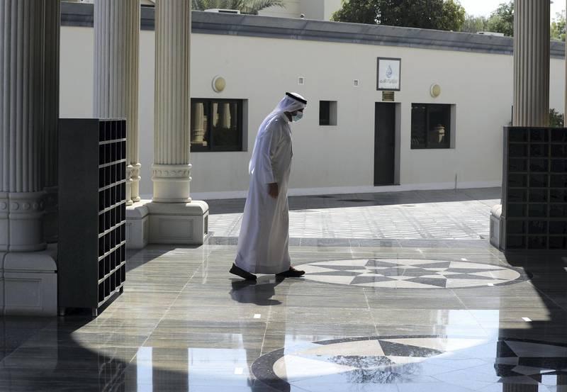 Dubai, United Arab Emirates - December 03, 2020: Dr Faris the imam at Al Farooq Omar Bin Al Khattab Mosque walks passed social distance markers. Thursday, December 3rd, 2020 in Dubai. Chris Whiteoak / The National
