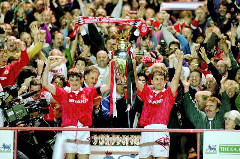 8 May 1993:  Steve Bruce and Bryan Robson of Manchester United celebrate with the premiership trophy after clinching the title during the FA Carling Premiership match against Coventry City played at Old Trafford in Manchester, England. \ Mandatory Credit:Allsport UK /Allsport