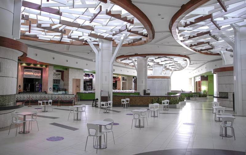 Abu Dhabi, United Arab Emirates, April 30, 2020.  The Yas Mall food court with tables distanced 2 meters apart.  Abu Dhabi officials on Wednesday said they were considering reopening malls soon, as they began a consultation with traders.Victor Besa / The NationalSection:  NAFor:  Standalone/Stock Images