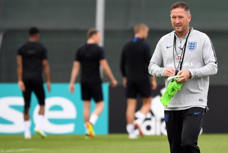 England's assistant coach Steve Holland attends a training session at Spartak Zelenogorsk Stadium in Saint Petersburg on June 19, 2018, during the Russia 2018 World Cup football tournament. / AFP / Paul ELLIS