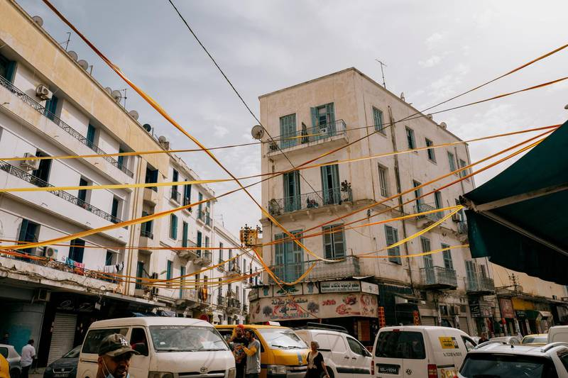 Red and gold streamers over the streets in Bab Souika on game day. Erin Clare Brown/ The National