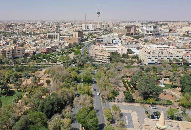"""An aerial picture shows cars driving on a tree-lined road in the Saudi capital Riyadh, on March 29, 2021. - Although the OPEC kingpin seems an unlikely champion of clean energy, the """"Saudi Green Initiative"""" aims to reduce emissions by generating half of its energy from renewables by 2030. (Photo by - / AFP)"""