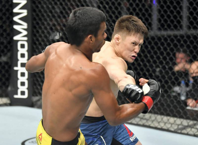 ABU DHABI, UNITED ARAB EMIRATES - JULY 12: (R-L) Zhalgas Zhumagulov of Kazakhstan punches Raulian Paiva of Brazil in their flyweight fight during the UFC 251 event at Flash Forum on UFC Fight Island on July 12, 2020 on Yas Island, Abu Dhabi, United Arab Emirates. (Photo by Jeff Bottari/Zuffa LLC)