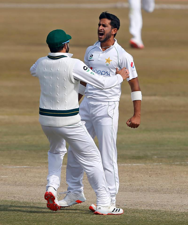 Pakistan's Hasan Ali, right, celebrates with teammates after taking the wicket of South Africa's Aiden Markram during the fifth day of the second cricket test match between Pakistan and South Africa at the Pindi Stadium in Rawalpindi, Pakistan, Monday, Feb. 8, 2021. (AP Photo/Anjum Naveed)