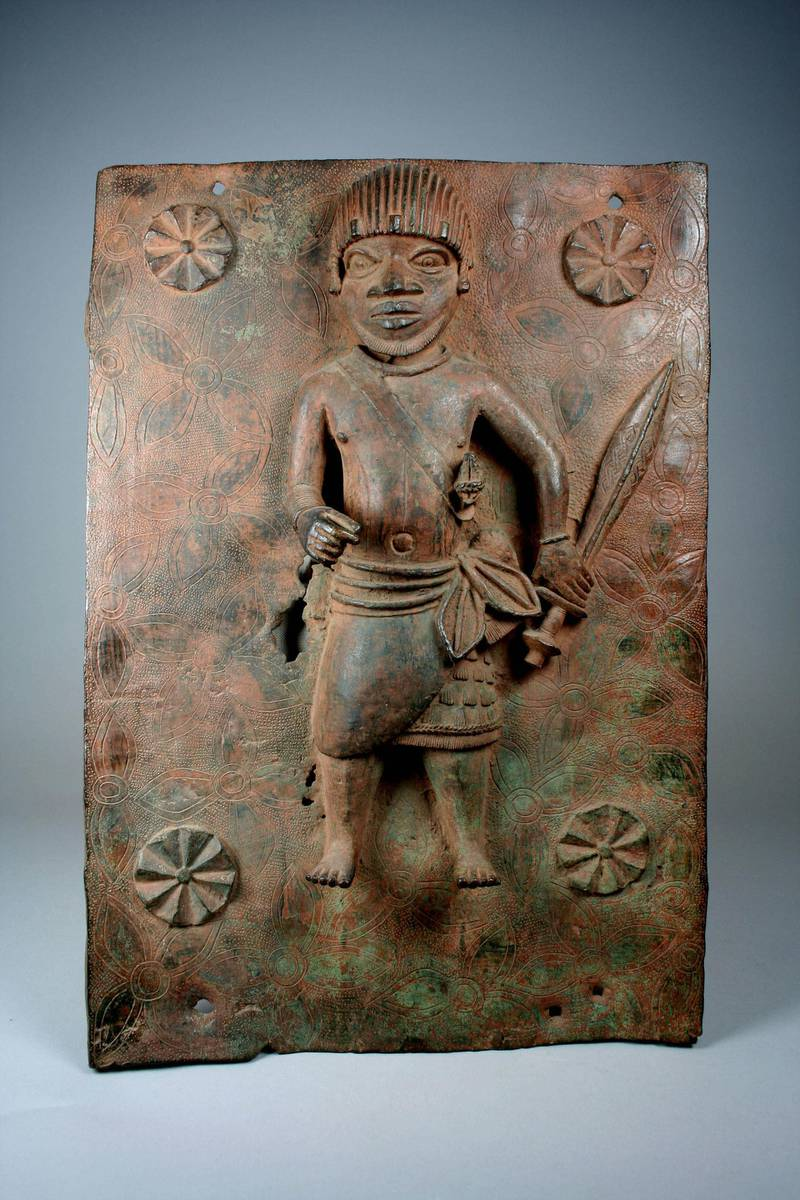 Plaque - Junior Court Official with Sword. Courtesy Metropolitan Museum of Art