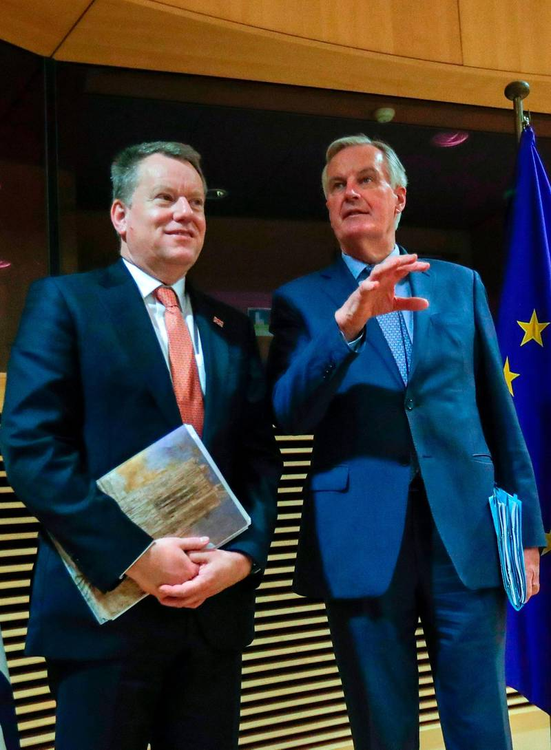 """(FILES) In this file photo taken on March 2, 2020 European Union chief Brexit negotiator Michel Barnier (R) and the British Prime Minister's Europe adviser David Frost  (L) pose for a photograph at start of the first round of post-Brexit trade deal talks between the EU and the United Kingdom, in Brussels.  Frost, 55, was appointed as Prime Minister Boris Johnson's so-called EU """"sherpa"""" shortly after the British leader took office in July 2019 and became chief trade negotiator after helping to finalise last year's divorce deal. / AFP / POOL / Olivier HOSLET"""