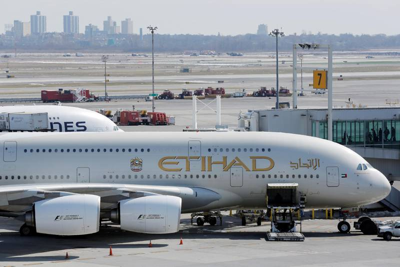 FILE PHOTO: An Etihad plane stands parked at a gate at JFK International Airport in New York, U.S., March 21, 2017.  REUTERS/Lucas Jackson/File Photo