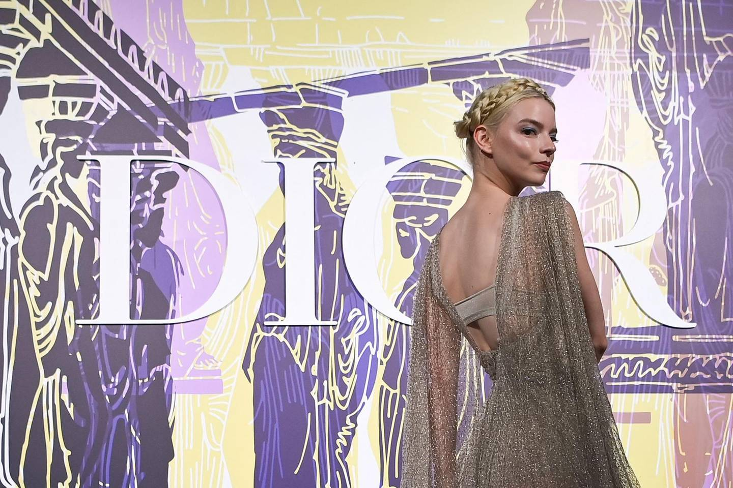 American-born Argentine-British actress and model Anya Taylor-Joy poses during the photocall before the 2022 Dior Croisiere (Cruise) fashion show, at the Panathenaic Stadium, in Athens, on June 17, 2021. / AFP / ARIS MESSINIS