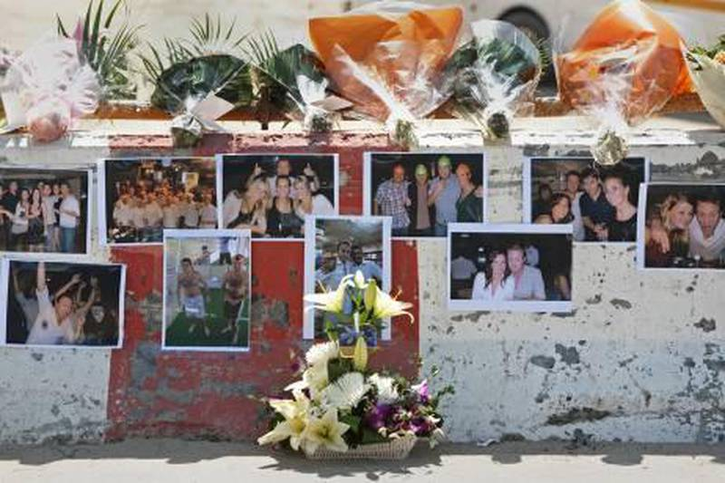 Dubai, March 21, 2011 - Friends have placed pictures and flowers on a barricade on the bridge that Elliot Lintott, 27, of Britain, fell off of and died early on March 19 in the Dubai Marina area in Dubai March 21, 2011. (Jeff Topping/The National)